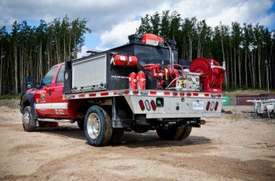 Firestorm Truck behind
