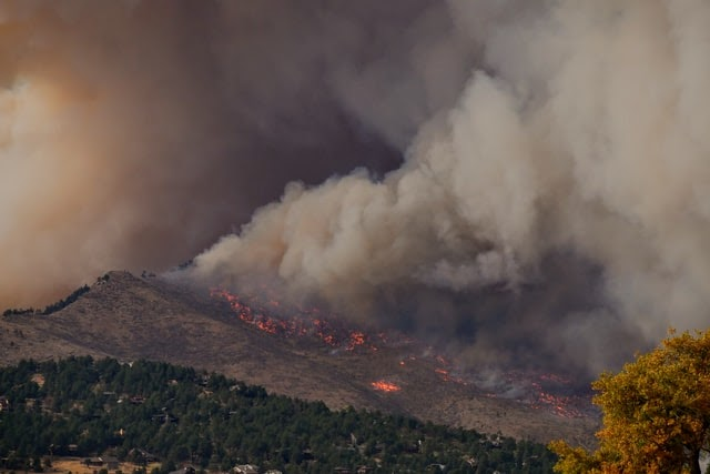 wildfire burning on a mountainside.
