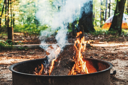 A campfire burning in a metal enclosure.